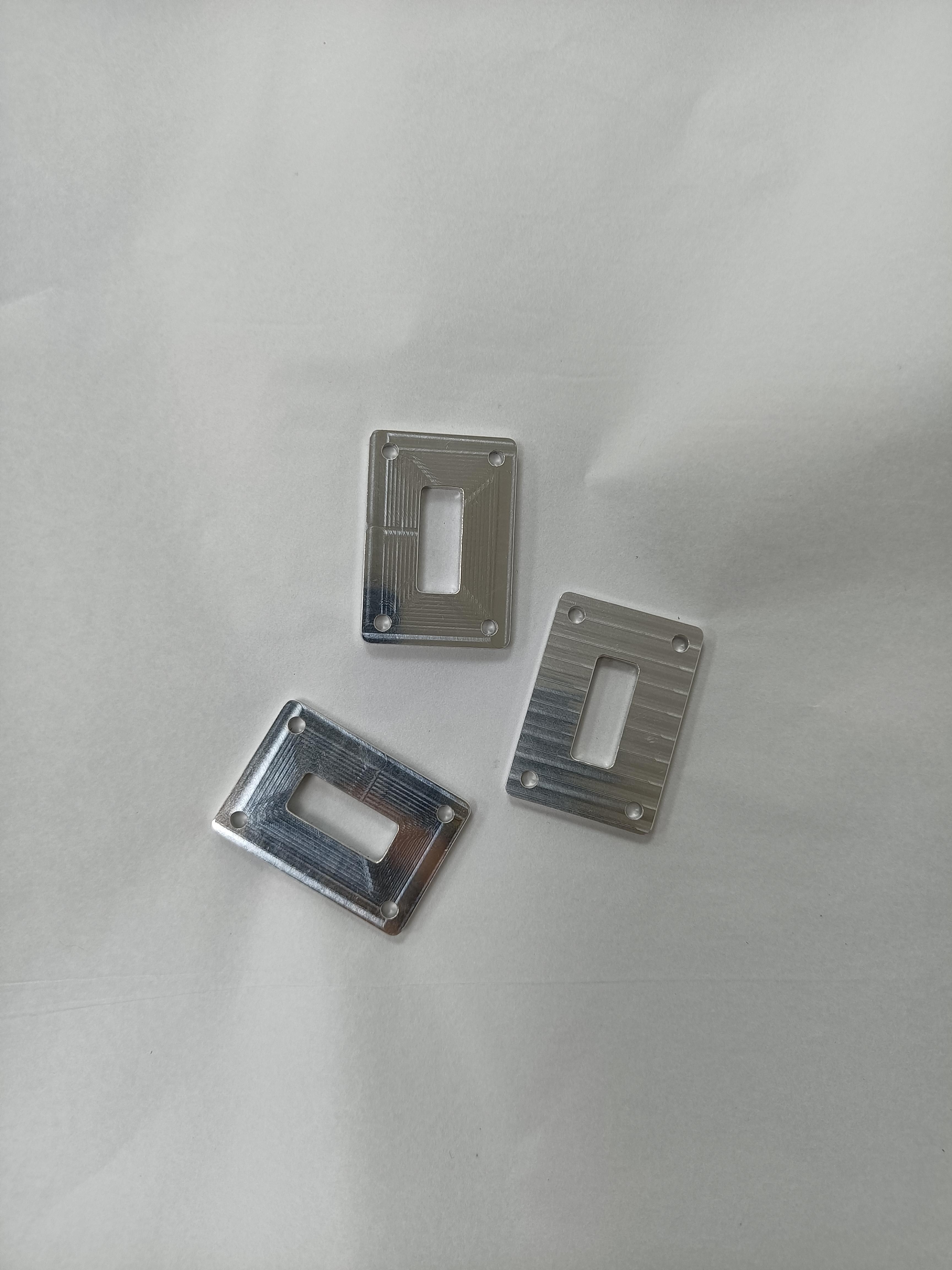 Four small aluminium parts - 3 of each